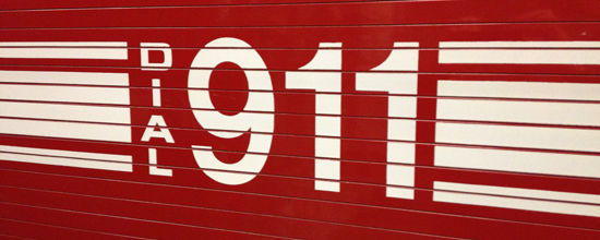 Call 9-1-1 signage on side of fire engine